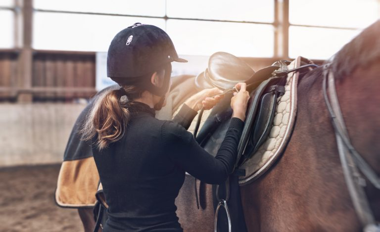 Rider adjusting the stirrup straps